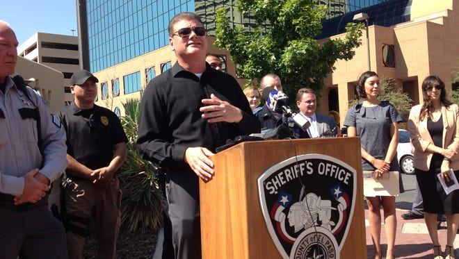 El Paso County Sheriff Richard Wiles announces a warrant roundup Wednesday at a news conference outside the El Paso County Jail in Downtown.