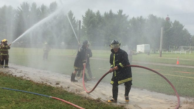 Firefights compete during the State Water Fight Championship at the Plainfield Fireman's Jamboree on Saturday in Plainfield.