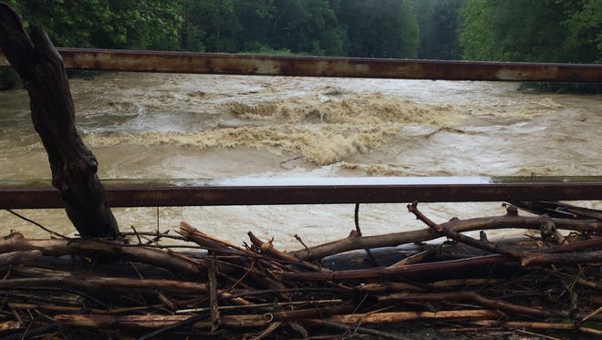 The Juneberry Road bridge in Vestal. The swollen waters of Choconut Creek crested at 13.8 feet early Monday morning.