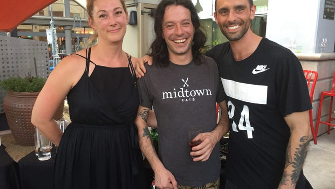 Chef Josh Berreman, center, of Midtown Eats takes a moment with the restaurant's owners, Sadie Bonnette and Ivan Fontana, after winning Artown Chefs Al Fresco July 24, 2017.