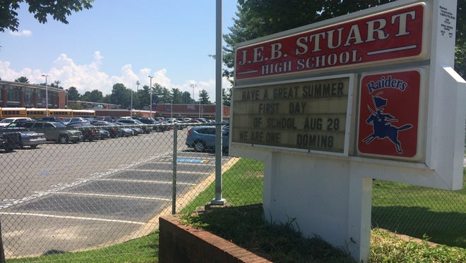 In this photo taken July 20, 2017, the sign for J.E.B. Stuart High School is photographed in Falls Church, Va. A two-year debate over whether to change the name of a northern Virginia high school honoring a Confederate general is coming to an end. The Fairfax County school board is scheduled to vote Thursday, July 27, 2017, on whether to change the name of J.E.B. Stuart High in Falls Church.