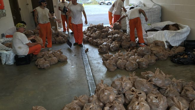 Several Stewart County jail inmates spent Tuesday bagging potatoes from large pallets that were donated on Monday.