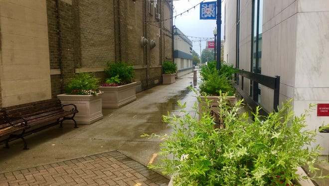The city is targeting alleyways, such as this one by Subway on 8th Street in Sheboygan, to beautify with planters and lighting.