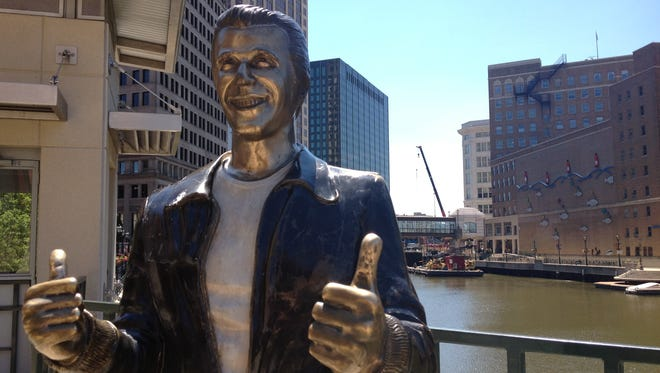 "This file photo shows ""The Bronze Fonz,"" a statue in the image of the character The Fonz, played by Henry Winkler in the 1970s series ""Happy Days,"" along the Milwaukee Riverwalk.  The riverwalk spans nearly three miles along the Milwaukee River, running from the East Side, through downtown and into the Third Ward neighborhood."