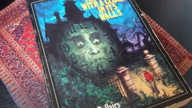 "A well-read copy of ""The House with a Clock in its Walls."""