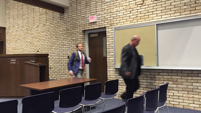 Adam Mait (l) and Jose Martinez of the Adler Group leave an executive session meeting with Ontario City Council on Wednesday night.