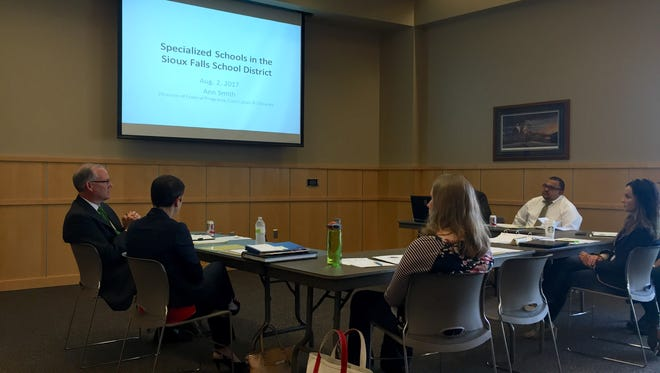 Board members learn about specialty schools during a meeting on August 2, 2017