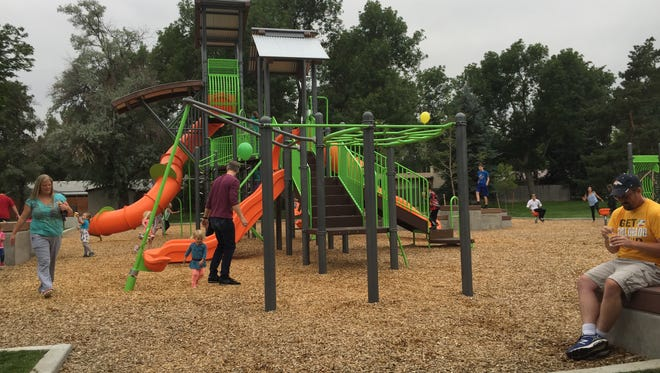 Residents enjoy the new playground at Avery Park in west Fort Collins. The park was upgraded as part of a city project to improve the neighborhood.