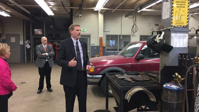 Mark Day leads a tour of the auto-shop at the Boys State Training School at Eldora in November 2016.