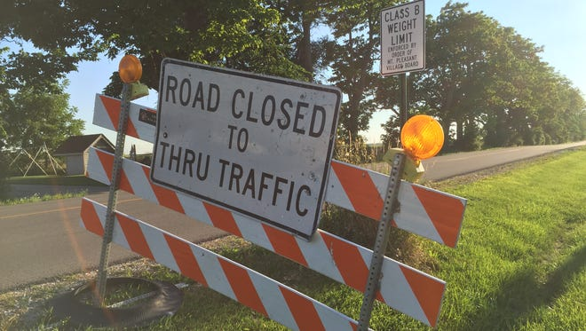 Road-closed barricades were put in place earlier in August as crews took soil samples beneath Braun Road in Racine County - one area of potential development by Foxconn Technology Group, the Taiwanese electronics giant.