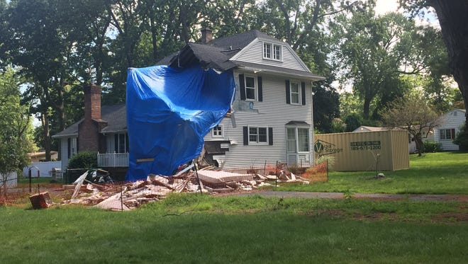 This home on Rock Beach Road hit by a falling tree remains unoccupied and unrepaired.