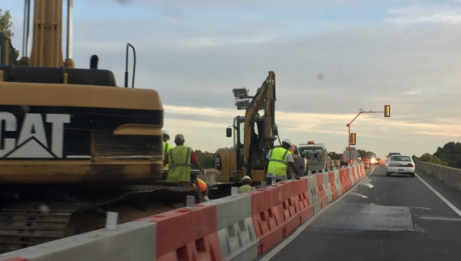 Workers on the McClure Bridge had one lane closed Friday night.