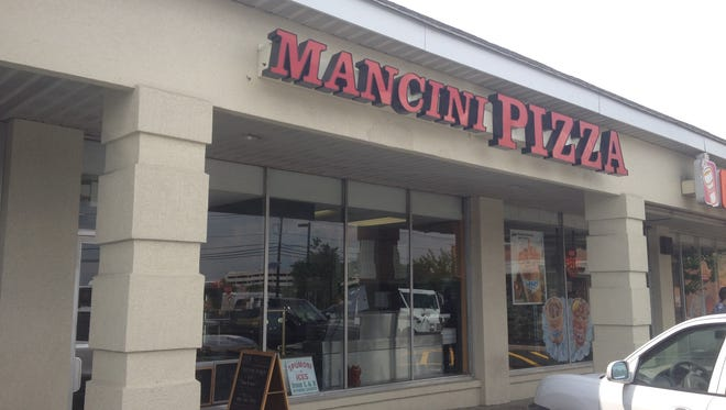 """Mancini Pizza in East Brunswick is in the middle of a social media frenzy stemming from an incident in which a police officer said she saw the word """"Pig"""" written on a pizza box."""