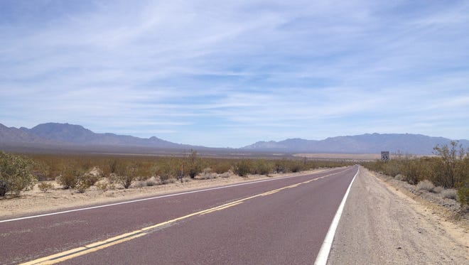 This photo shows a road that stretches through the Mojave Desert. An Orange County couple died while hiking near Amboy Crater, which is in the Southern California desert region.