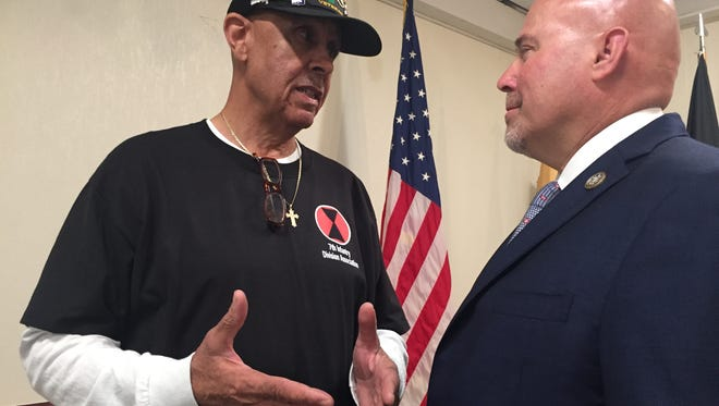 Rep. Thomas MacArthur, R-N.J., chats with Army veteran Garfield Harper Jr. of Westampton in Pemberton last year. The congressman sponsored legislation to help veterans like Harper who developed health issues after exposure to the chemical Agent Orange in or near the Demilitarized Zone in Korea in 1967-68. The measure passed the House this week as part of a wider bill that included other Vietnam era veterans who served at sea or in the air near  the Vietnam coast.
