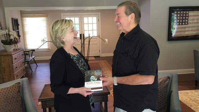 "Former Secretary of State Hillary Clinton and the Rev. Bill Shillady with a copy of Shillady's new book, ""Strong for a Moment Like This"""