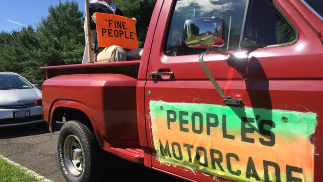 The President Donald Trump effigy in the back of the People's Motorcade pickup truck.