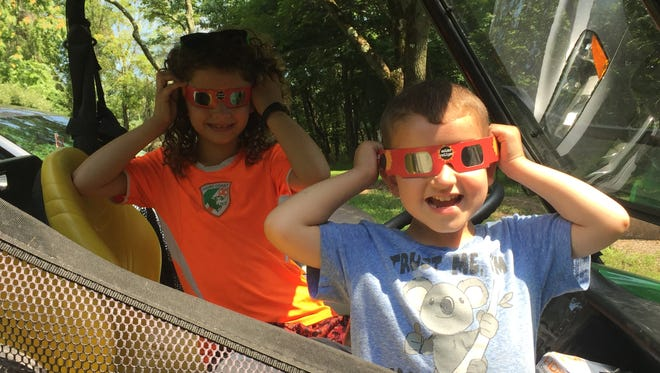 """With millions of people, including Emily, 7, and Jack Nason, 3, of Hillsborough in the path of the """"Great American Eclipse,"""" locally, the Bridgewater branch of the Somerset County Library System of New Jersey (SCLSNJ) drew about 300 while a viewing event at the Raritan Valley Community College in Branchburg had more than 2,000 attend. GSHNJ had 15 Girl Scouts along with about 20 adults at their program. Participants from GSHNJ's special eclipse programming earned the """"Solar Eclipse GSHNJ Fun Patch"""" and certificate as they kicked off the STEM-inspired """"Reaching for the Stars: NASA Science for Girl Scouts"""" program."""