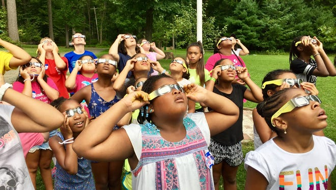 Girl Scouts watch the solar eclipse at Jockey Hollow Camp.
