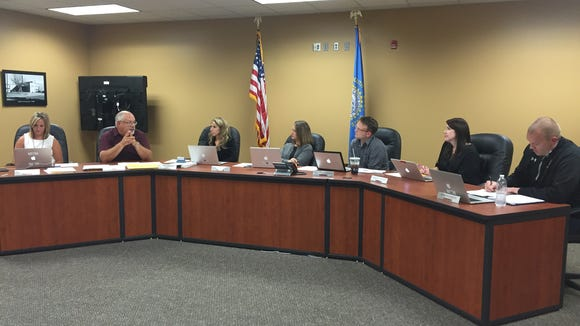 Harrisburg School Board members discuss an early college