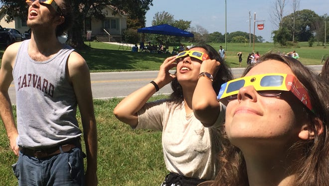 Eclipse enthusiasts watch the beginnings of the solar eclipse Monday, Aug. 21, near Barren Plains in Robertson County.