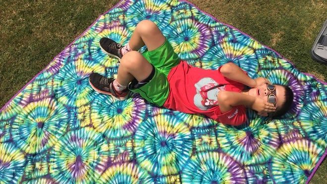 Lipscomb Elementary 1st grade student Michael Landa looks at the solar eclipse on Mon. Aug. 21.