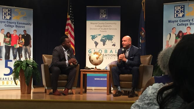 Nikolai Vitti, superintendent of the Detroit Public Schools Community Districts, right, speaks during a forum at the Wayne County Community College District campus in Detroit. The discussion was moderated by Bankole Thompson, a Detroit News columnist.