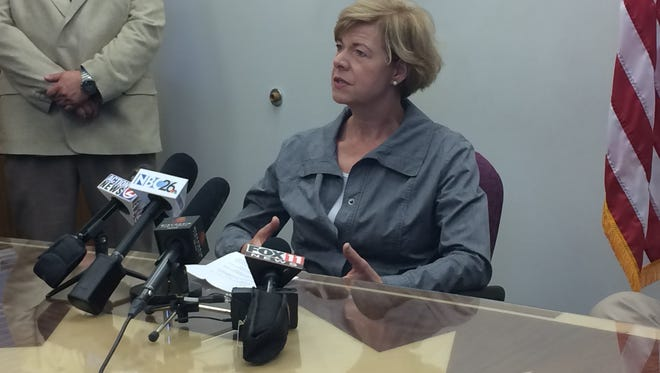 U.S. Sen. Tammy Baldwin speaks with reporters after her visit to Gulfstream in Greenville on Tuesday.