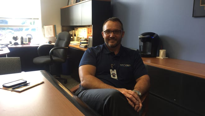 Mike Cady takes a moment to relax from his duties as the new superintendent in the Pewaukee School District.