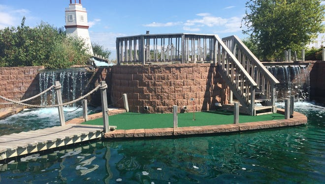Swing Time in Germantown offers a mini-golf course with plenty of elevation and tricky holes as well as the decor of three waterfalls and a lighthouse.