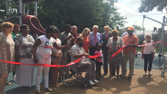 Wilmington elected officials and community leaders celebrate the unveiling of a renovated park at Third and Connell streets. The improvements were made possible by West Side Grows Together and other community groups.