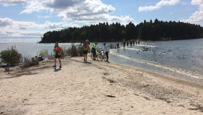 Tourists try to cross to Cana Island, despite high water levels.