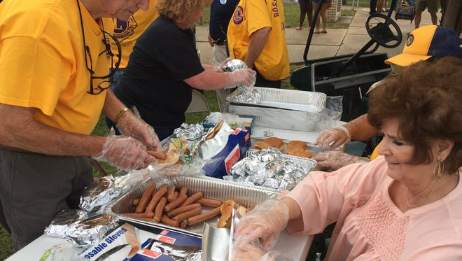 Bossier Lions Club members were serving up hotdogs and hamburgers Friday night during their 64th jamboree.