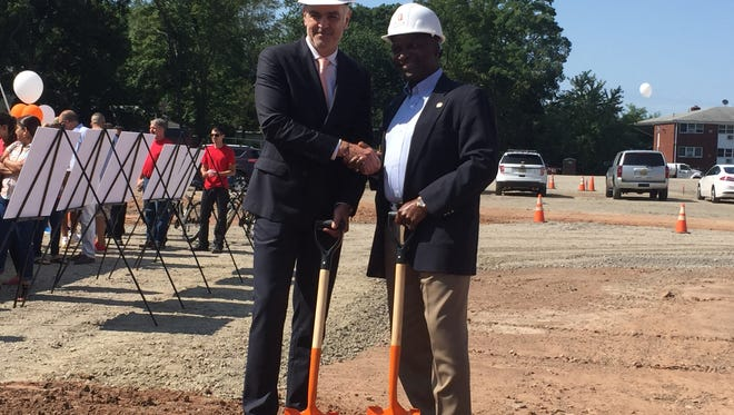 Plainfield Mayor Adrian Mapp and Joseph Forgione, president of JMF Properties, pose for a photo at the groundbreaking ceremony of Plainfield's largest residential redevleopment project.