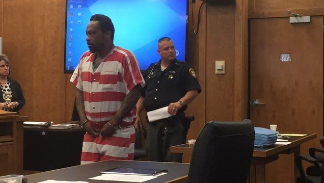 Dennis Heard walks into Richland County Common Pleas Court on Monday.