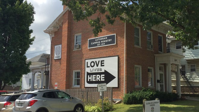 The University of Iowa is seeking permission to purchase this property at 109 E. Market St. The building, which dates back to the 1850s, is owned by Gloria Dei Lutheran Church and houses the church's campus ministry.