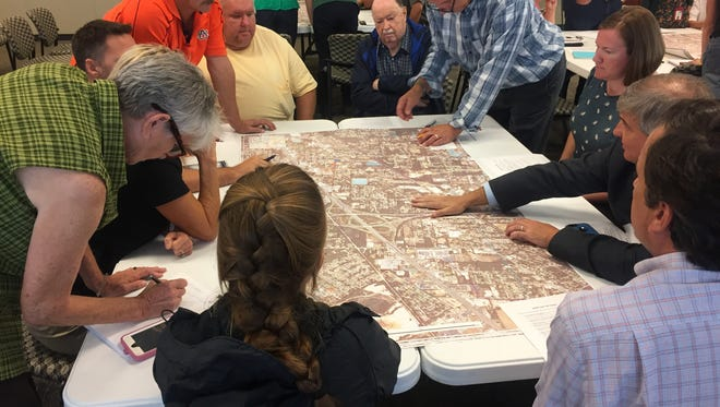 Stakeholders point out potential sources of pollution around the Carpenter Creek watershed at a meeting Aug. 30, 2017.