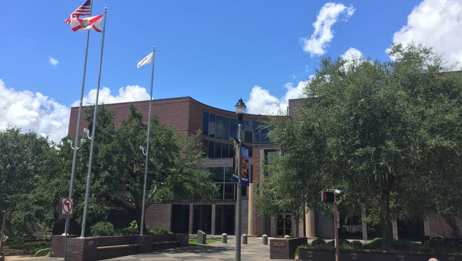 The white Tallahassee city flag flies at city hall, the airport and the consolidated dispatch center