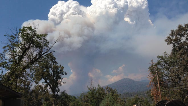 Smoke, caused by the Railroad Fire, fills the Sierra National Forest near the community of Sugar Pine, south of Yosemite National Park and Fish Camp.