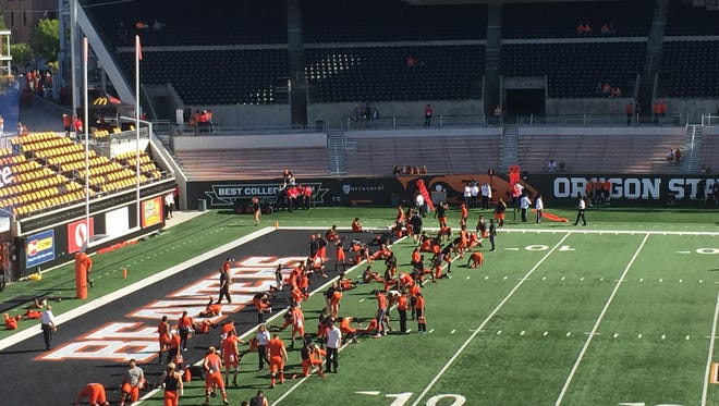 Oregon State players warm up before Saturday's game against Portland State at Reser Stadium.