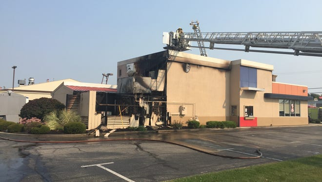 Muncie firefighters battled a blaze that damaged the Dairy Queen restaurant at 3820 W. Bethel Avenue on Monday afternoon.