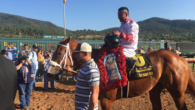 Jockey Jose Amador Alvarez celebrates aboard Fly Baby Fly, the All American Futurity 2017 winner. The 2-year-old filly used a late kick to capture the top prize in quarter horse racing at the Ruidoso Downs Race Track and Casino.