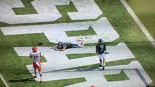 Matt Sokol, shown here on ESPNU's broadcast, lays on the Spartan Stadium turf after dropping an easy touchdown during Saturday's game.