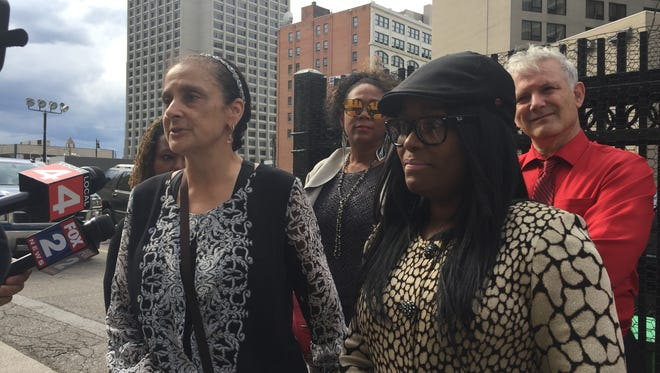 Katarina Brown, right, and attorney Shanta Driver discuss a federal lawsuit filed today against the Detroit school district, Mayor Mike Duggan, and a number of other people.
