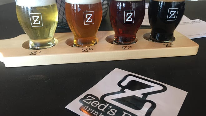 A flight of Zed's Beer sits on a bistro table at the new Marlton brewery.