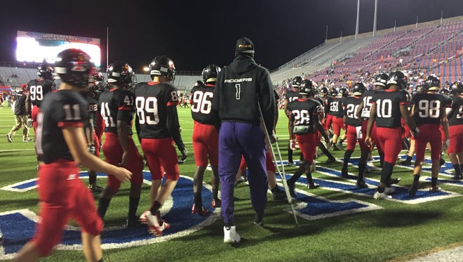 Parkway quarterback Justin Rogers walks on crutches prior to Friday's game with Pearl, Mississippi.