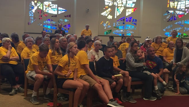 Volunteers meet at St. James Lutheran Church Sept. 10 to participate in 'God's Work, Our Hand.'