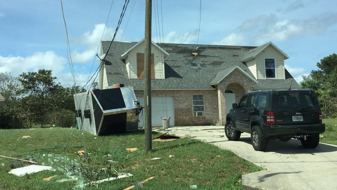 Damage in Mims from a tornado spun up by Hurricane Irma