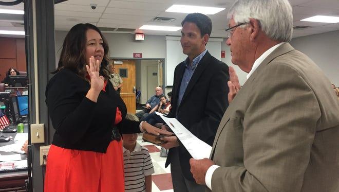 Jennifer Mason takes oath as an interim Williamson County commissioner.