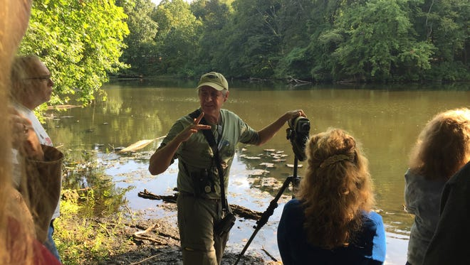 Naturalist and bird-watcher Lloyd Smith leads a nature tour around Laurel Lake at the proposed Whitman Woods in Laurel Springs. Poet Walt Whitman spent summers late in life in the borough and wrote poetry about it.